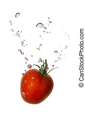 Tomato in water with air bubbles