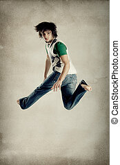 Dance and Jumping - Young modern man jumping over grunge...