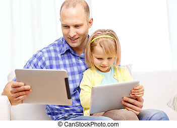 happy father and daughter with tablet pc computer - family,...