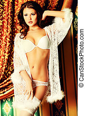 negligee - Attractive young woman alluring in sexual white...