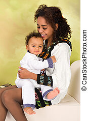 Ethiopian mother hugging baby - Ethiopian mother in national...
