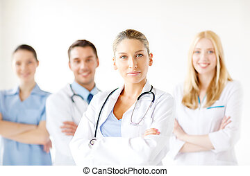 serious female doctor in front of medical group - healthcare...