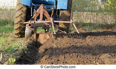 Tractor working in the field