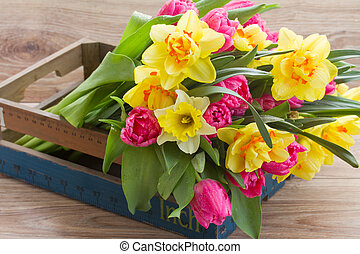 bunch of spring flowers in wooden crate - bunch of spring...