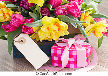 spring flowers with gift box and empty tag