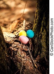 colored eggs lying at fore - Photo of colored eggs lying at...