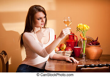 Wine lover. - Portrait of a gorgeous young brunette woman...