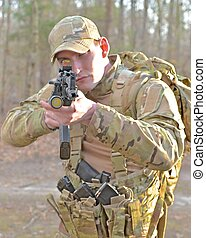 Special Forces Soldier - A special forces soldier aims his...