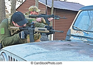 Special Forces Soldiers - A special forces team fires from...