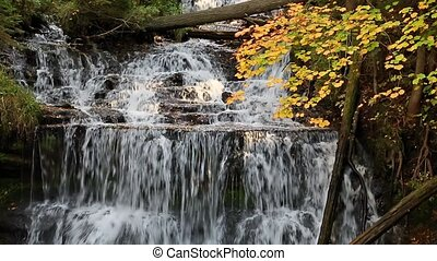 Wagner Falls in Autumn Loop - Whitewater flows over Wagner...