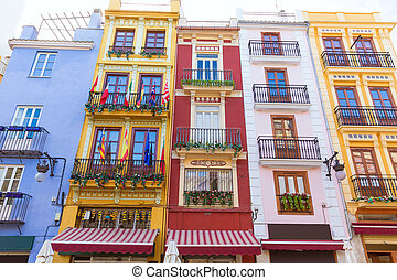 Valencia colorful facades in front Mercado Central at Spain...