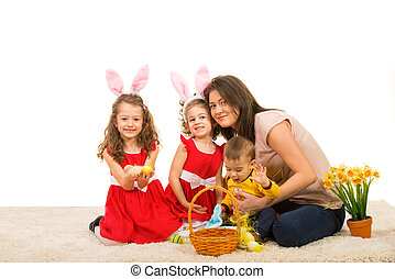 Beautiful Easter family sitting togetheron carpet home