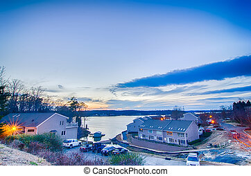 sunset over lake and residential area at lake wylie