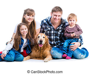 parents two daughters with a dog - happy smiling familiy...