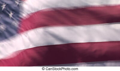 American Flag - The American flag waving patriotically in...