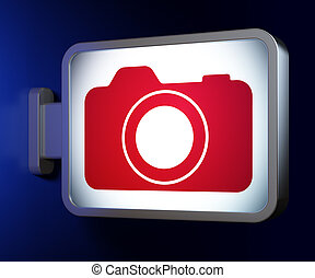 Vacation concept: Photo Camera on billboard background -...