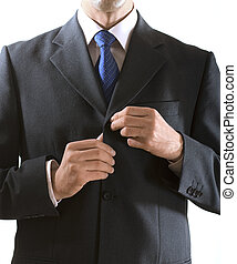 hands of man - businessman buttons up the button on the suit
