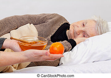 Home care - Portrait of an elderly wrinkled woman lying in...