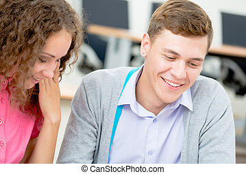 students together to discuss lecture - image of a two...