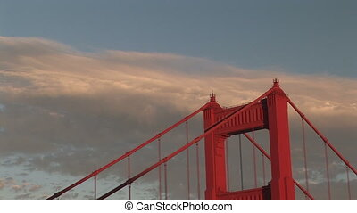 Seagulls flying over Golden Gate Bridge towers, San...