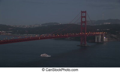 Golden Gate Bridge at night - Cars driving along the Golden...