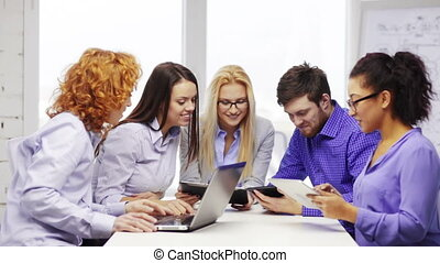 smiling team with laptop and table pc computers - business,...