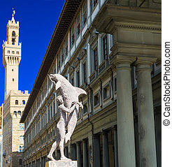 Florence - Man with dolphin, Clock Tower of Palazzo Vecchio...
