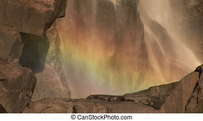 Rainbow at Bridal veil Falls, Yosemite National Park,...