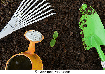 Gardening tools,watering can, plants and soil