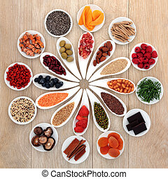 Power Food - Healthy super food selection in white porcelain...