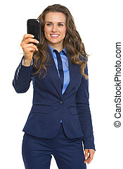 Happy business woman taking photo with phone