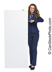 Full length portrait of smiling business woman showing blank...