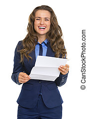 Happy business woman reading letter