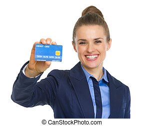 Happy business woman showing credit card