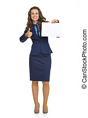 Full length portrait of happy business woman showing blank paper sheet and thumbs up