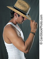Muscular man with hat - Portrait of young muscular man...