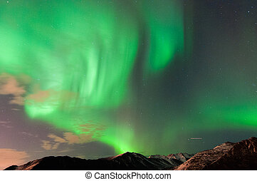 Northern Lights - The northern lights over mountains.