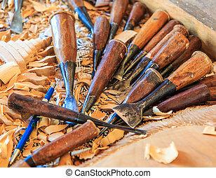 Woodcraftsman is carving wood or Work Of Artist or wood...