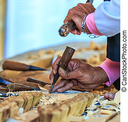 Woodcraftsman is carving wood or Work Of Artist or wood...
