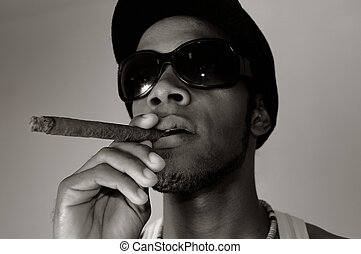 African man smoking cigar - Portrait of young trendy african...