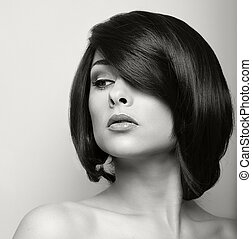 Beautiful woman with short black hair. Hair style. Black and...