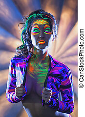 Portrait of attractive woman with UV disco make-up - Image...