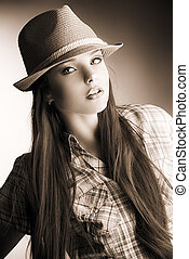 blakandwhite - Portrait of a pretty girl in hat posing at...