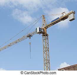 High crane on a building site - High jib crane working on...
