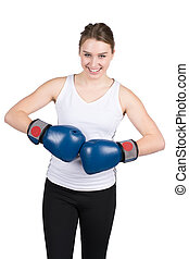 Woman holds boxing gloves against each other - Cut out image...