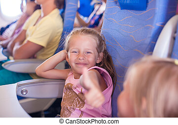 Little happy girl in the airplane