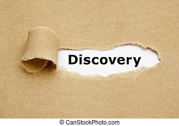 Discovery Torn Paper Concept - The word Discovery appearing...
