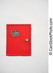 Electricity meter box door - Red electricity meter door on a...