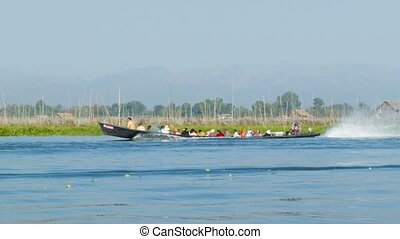 Boat with local people on Inle lake Burma - High definition...