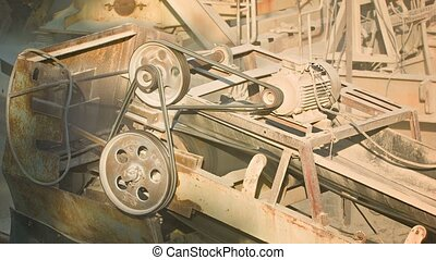 Industrial dusty old rusty machinery Stone crusher in action...